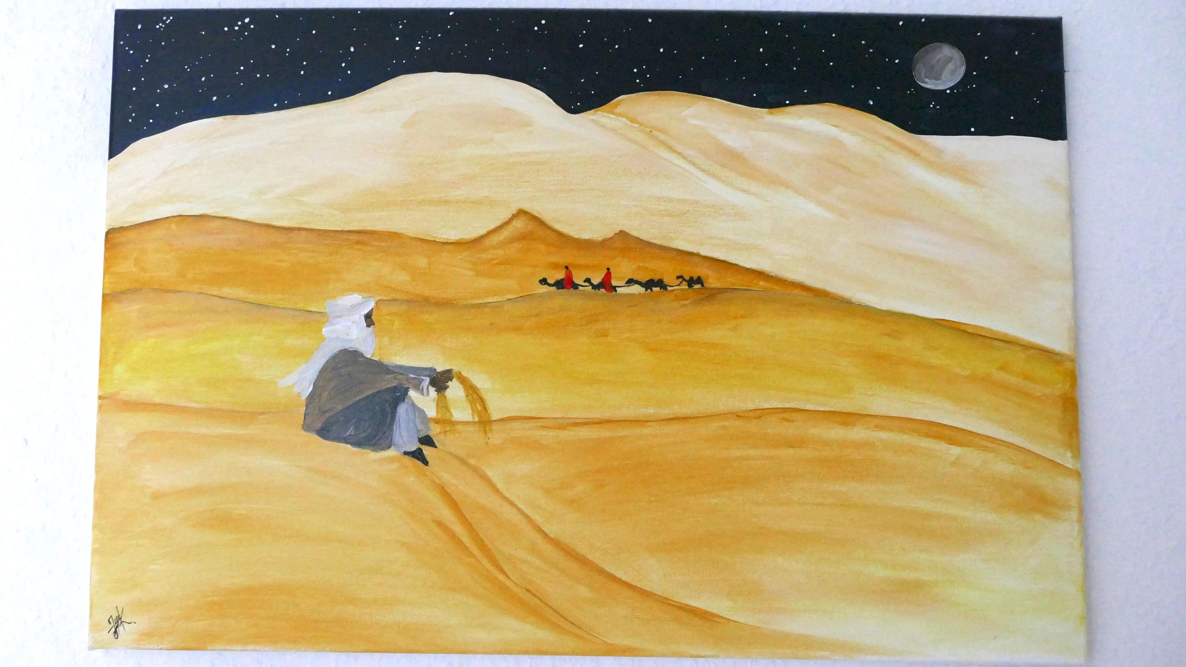 Eine Leinwand in Acrylfarbe, die eine Wüstenlandschaft zeigt